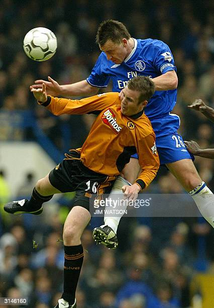 Chelsea's captain John Terry jumps for a head ball against Wolverhampton's Kenny Miller during their Premiership football match 27 March 2004 at...