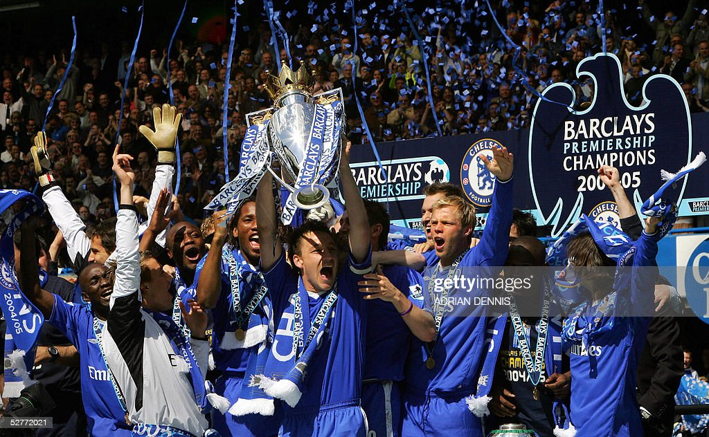 Chelsea's Captain John Terry (C) lifts the Barclays Premiership trophy alongside the rest of the team during the celebration after the game against Charlton at Stamford Bridge in London 07 May 2005. AFP PHOTO Adrian DENNIS No telcos, website uses subject to subscription of a license with FAPL on www.faplweb.com <http://www.faplweb.com>