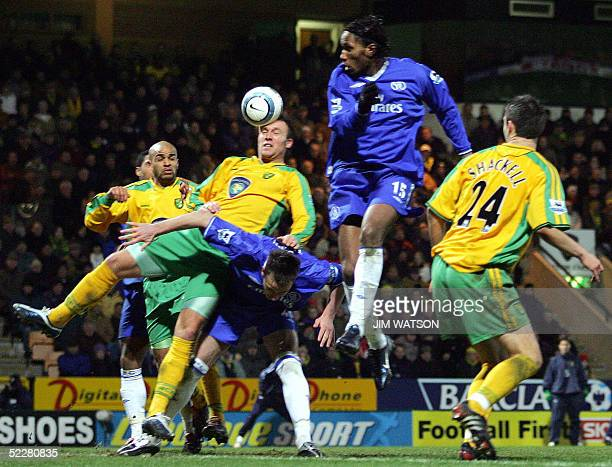 Chelsea's captain John Terry trips up Norwich City's Dean Ashton as he jumps for a header from a corner kick during Premiership football at Carrow...