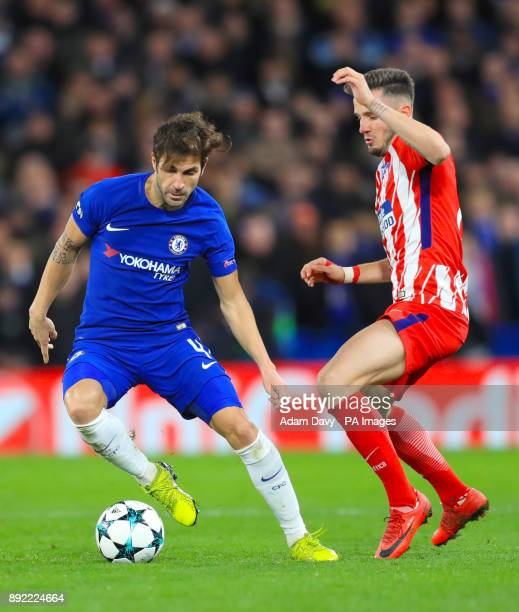 Chelsea's Cesc Fabregas and Atletico Madrid's Saul Niguez battle for the ball