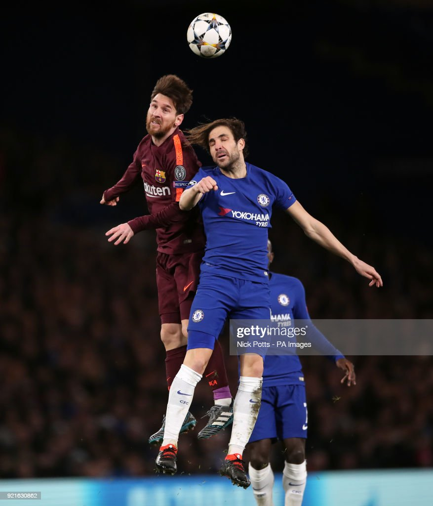 Chelsea's Cesc Fabregas (right) and Barcelona's Lionel Messi battle for the ball during the UEFA Champions League round of sixteen, first leg match at Stamford Bridge, London.