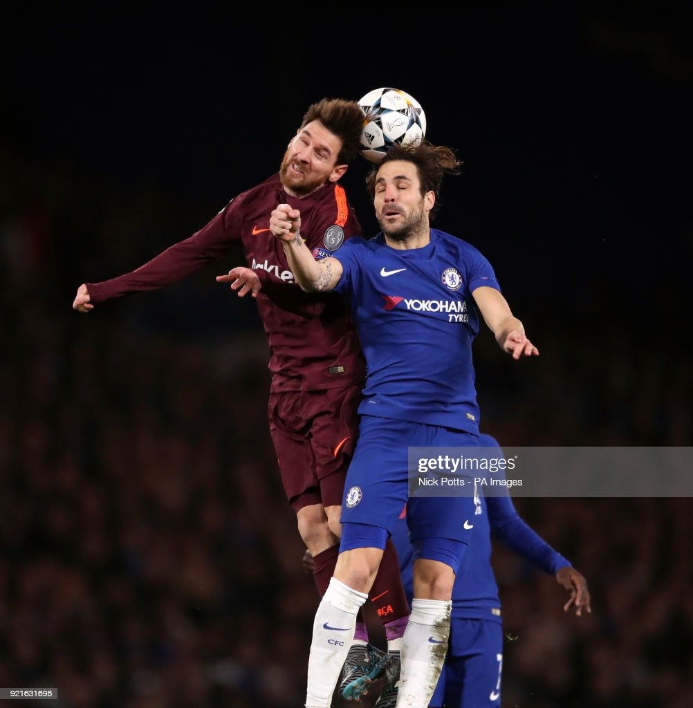 Chelsea's Cesc Fabregas (right) and Barcelona's Lionel Messi battle for the ball during the UEFA Champions League round of sixteen, first leg match at Stamford Bridge, London. PRESS ASSOCIATION Photo. Picture date: Tuesday February 20, 2018. See PA story SOCCER Chelsea. Photo credit should read: Nick Potts/PA Wire