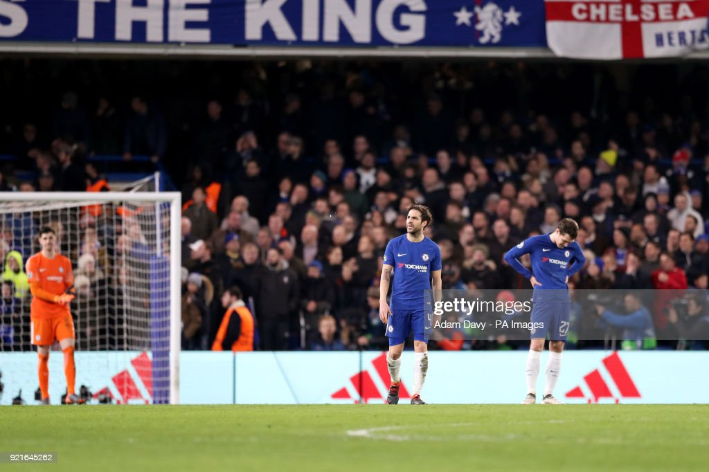 Chelsea's Cesc Fabregas (centre) and Davide Zappacosta appear dejected after Barcelona's Lionel Messi (not pictured) scores his side's first goal of the game during the UEFA Champions League round of sixteen, first leg match at Stamford Bridge, London.