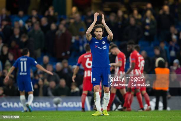 Chelsea's Cesc Fabregas applauds the fans at the final whistle during the UEFA Champions League group C match between Chelsea FC and Atletico Madrid...