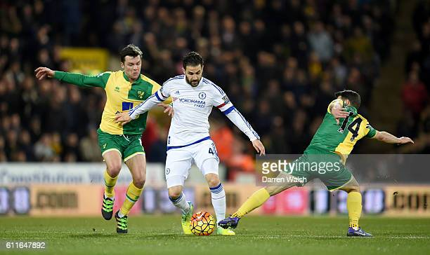 Chelsea's Cesc Fabregas gets away from Norwich City's Jonny Howson and Wesley Hoolahan