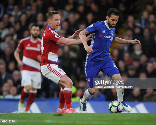 Chelsea's Cesc Fabregas holds off the challenge from Middlesbrough's Adam Forshaw during the Premier League match between Chelsea and Middlesbrough...
