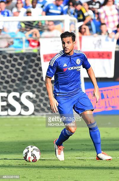 Chelsea's Cesc Fabregas moves the ball during an International Champions Cup football match against Paris SaintGermain in Charlotte North Carolina on...