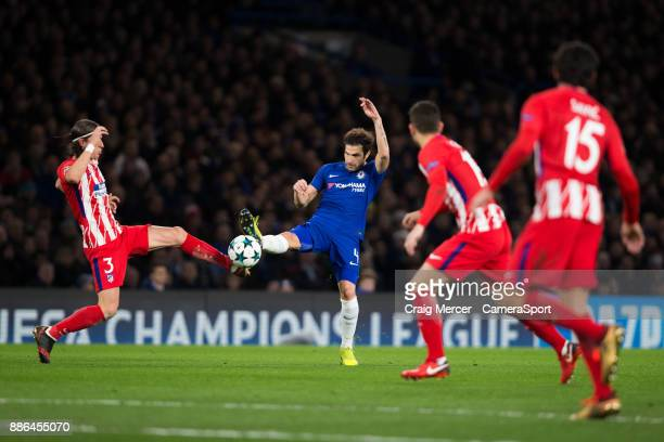 Chelsea's Cesc Fabregas vies for possession with Atletico Madrid's Filipe Luis during the UEFA Champions League group C match between Chelsea FC and...