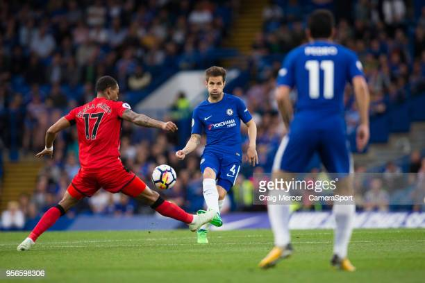 Chelsea's Cesc Fabregas vies for possession with Huddersfield Town's Rajiv van La Parra during the Premier League match between Chelsea and...