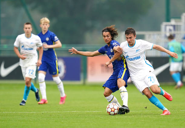 Chelsea's Charlie Webster and Zenit St. Petersburg's Ruslan Khailoev battle for the ball during the UEFA Youth League, group H match at Cobham...