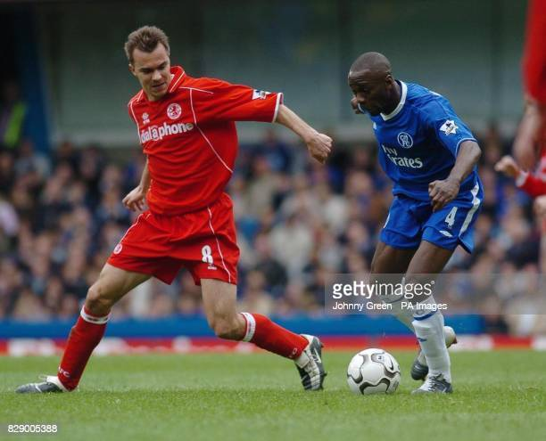 Chelsea's Claude Makelele is challenged by Middlesbrough's Szilard Nemeth during the Barclaycard Premiership match at Stamford Bridge London THIS...