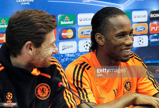 Chelsea's coach Andre Villas Boas and Ivorian forward Didier Drogba take part in a press conference at the San Paolo Stadium in Naples on February 20...