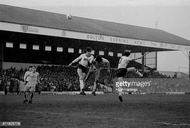 Chelsea's Colin Lee challenges for a high cross in the Bolton penalty area
