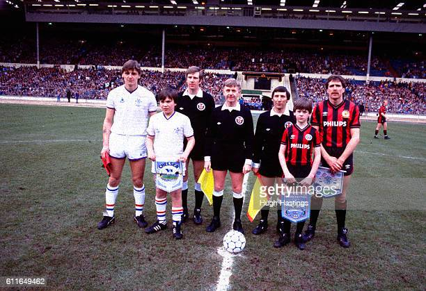 Chelsea's Colin Pates and Manchester City's Paul Power before the game with match referee Mr Alan Saunders