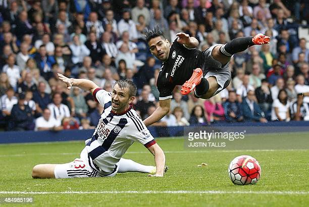 Chelsea's Colombian striker Radamel Falcao has a shot on goal by West Bromwich Albion's Northern Irish defender Gareth McAuley during the English...
