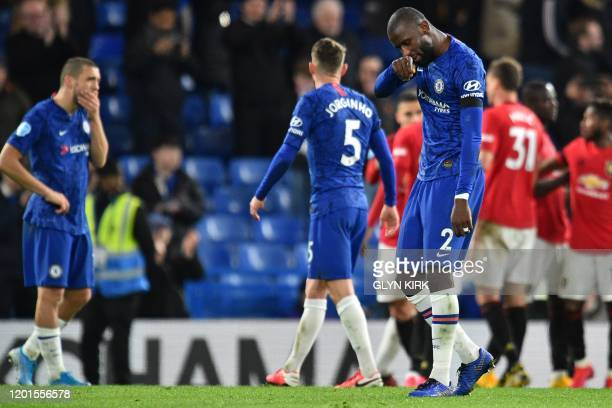 Chelsea's Croatian midfielder Mateo Kovacic and Chelsea's German defender Antonio Rudiger react to their defeat on the pitch after the English...