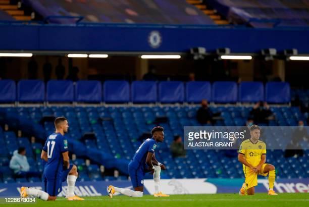 Chelsea's Croatian midfielder Mateo Kovacic , Chelsea's English striker Tammy Abraham and Barnsley's Austrian striker Patrick Schmidt take a knee...