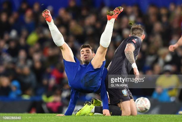 Chelsea's Croatian midfielder Mateo Kovacic is tackled by Sheffield Wednesday's Scottish striker Steven Fletcher during the English FA Cup fourth...