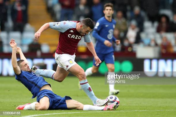 Chelsea's Croatian midfielder Mateo Kovacic tackles Aston Villa's Scottish midfielder John McGinn during the English Premier League football match...