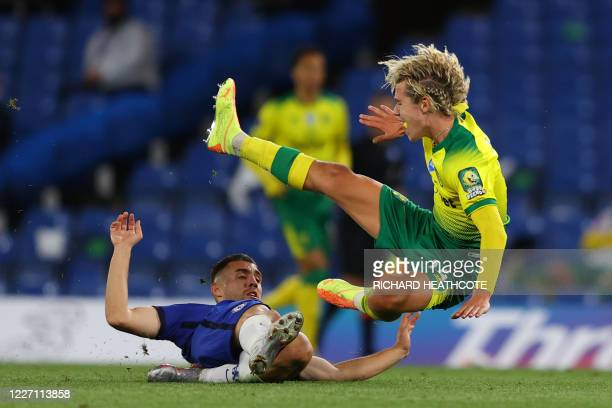 Chelsea's Croatian midfielder Mateo Kovacic tackles Norwich City's English midfielder Todd Cantwell during the English Premier League football match...