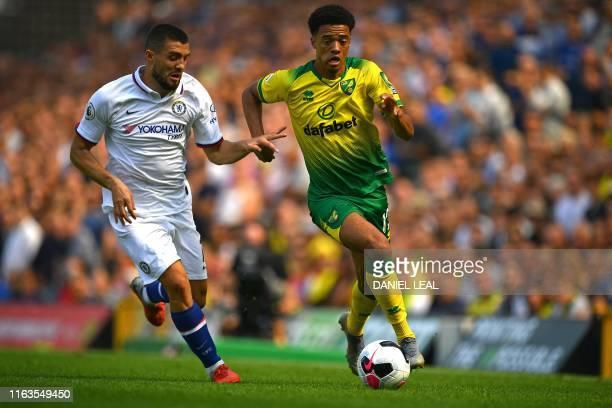 Chelsea's Croatian midfielder Mateo Kovacic vies with Norwich City's English-born Northern Irish defender Jamal Lewis during the English Premier...