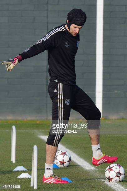 Chelsea's Czech goalkeeper Petr Cech attends a training session at the club's training ground in Cobham Surrey south of London on December 10 2013 on...