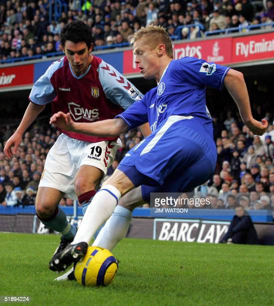 Chelsea's Damien Duff juggles the ball around Aston Villa's Liam Ridgewell during their Premiership football match 26 December 2004 at Stamford...