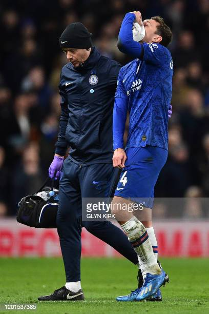 Chelsea's Danish defender Andreas Christensen is helped from the pitch after picking up an injury in a clash with Manchester United's French striker...