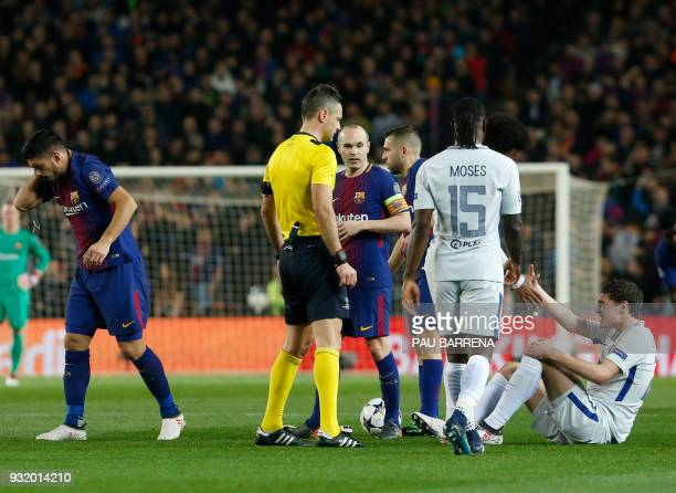 Chelsea's Danish defender Andreas Christensen is helped stand up during the UEFA Champions League round of sixteen second leg football match between...