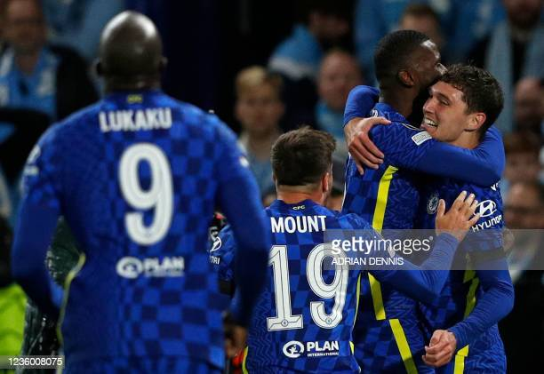 Chelsea's Danish defender Andreas Christensen is mobbed by teammates after scoring the team's first goal during the Champions League group H football...