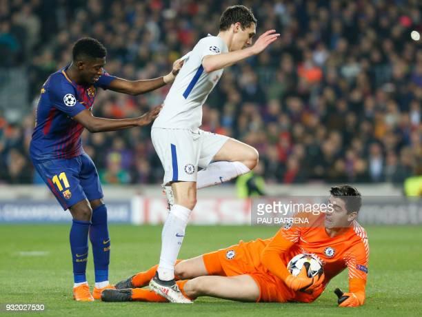 Chelsea's Danish defender Andreas Christensen jumps over Chelsea's Belgian goalkeeper Thibaut Courtois beside Barcelona's French forward Ousmane...