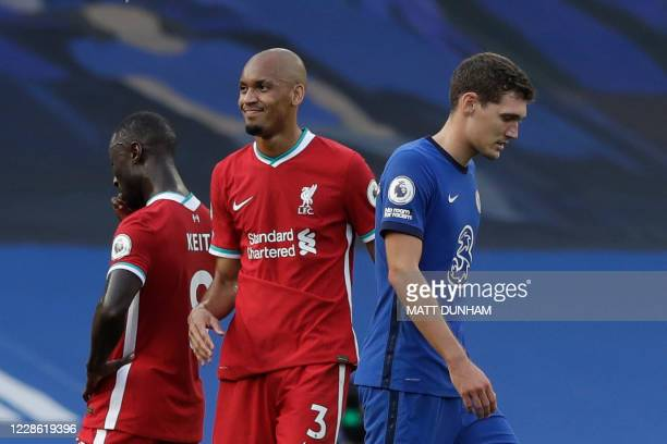 Chelsea's Danish defender Andreas Christensen leaves the pitch after receiving a red card during the English Premier League football match between...