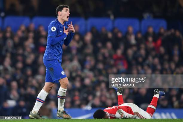 Chelsea's Danish defender Andreas Christensen reacts after fouling Arsenal's French striker Alexandre Lacazette during the English Premier League...