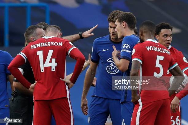 Chelsea's Danish defender Andreas Christensen reacts after receiving a red card during the English Premier League football match between Chelsea and...