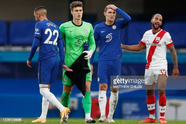Chelsea's Danish defender Andreas Christensen reacts beside Southampton's English striker Theo Walcott and Chelsea's Spanish goalkeeper Kepa...
