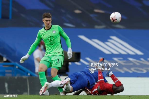 Chelsea's Danish defender Andreas Christensen tackles Liverpool's Senegalese striker Sadio Mane and is given a red card during the English Premier...