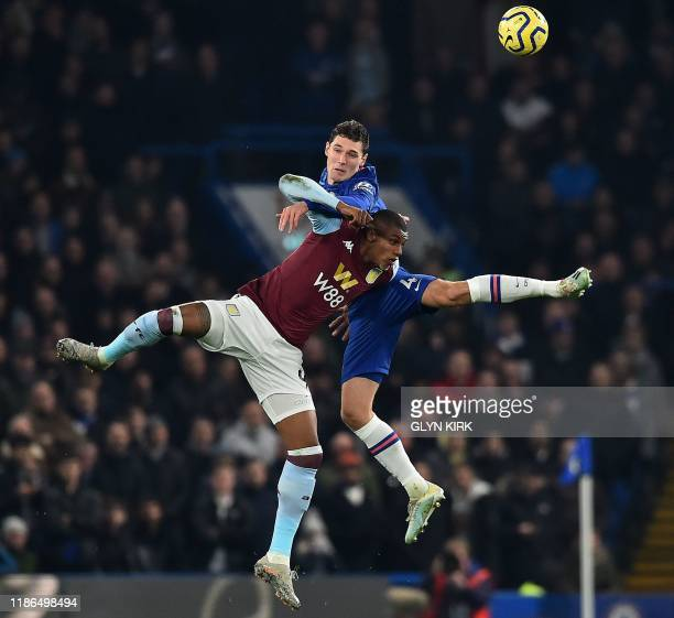 TOPSHOT Chelsea's Danish defender Andreas Christensen vies with header the ball with Aston Villa's English defender Axel Tuanzebe during the English...