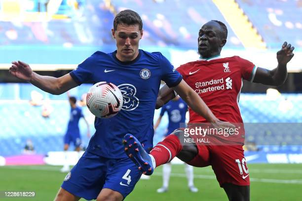 Chelsea's Danish defender Andreas Christensen vies with Liverpool's Senegalese striker Sadio Mane during the English Premier League football match...