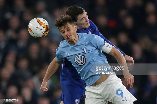 Chelsea's Danish defender Andreas Christensen vies with Malmö FF's Swedish striker Markus Rosenberg during the UEFA Europa League round of 32 2nd leg...