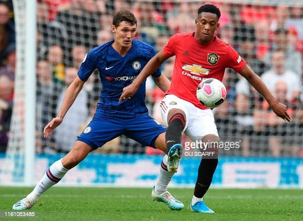 Chelsea's Danish defender Andreas Christensen vies with Manchester United's French striker Anthony Martial during the English Premier League football...