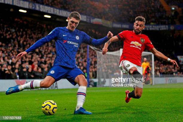 Chelsea's Danish defender Andreas Christensen vies with Manchester United's Portuguese midfielder Bruno Fernandes during the English Premier League...