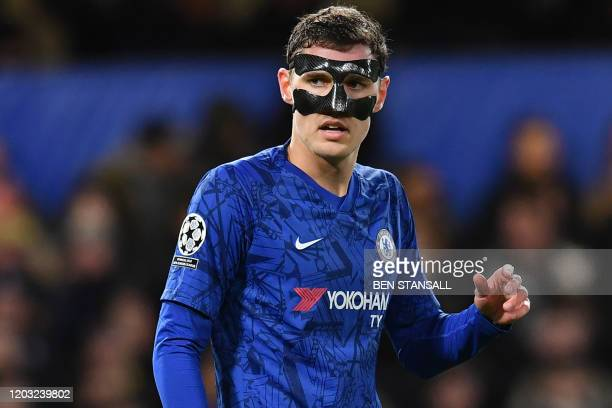 Chelsea's Danish defender Andreas Christensen wears a mask during the UEFA Champion's League round of 16 first leg football match between Chelsea and...