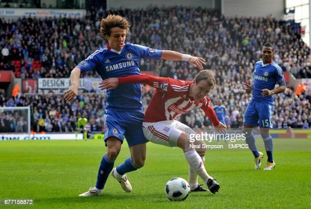 Chelsea's David Luiz and Stoke City's Glenn Whelan battle for the ball