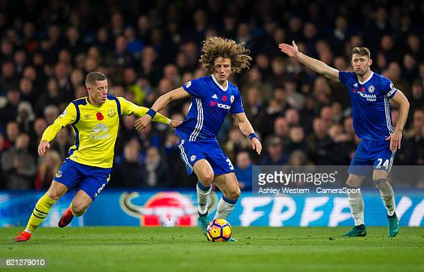 Chelsea's David Luiz holds off the challenge from Everton's Ross Barkley during the Premier League match between Chelsea and Everton at Stamford...