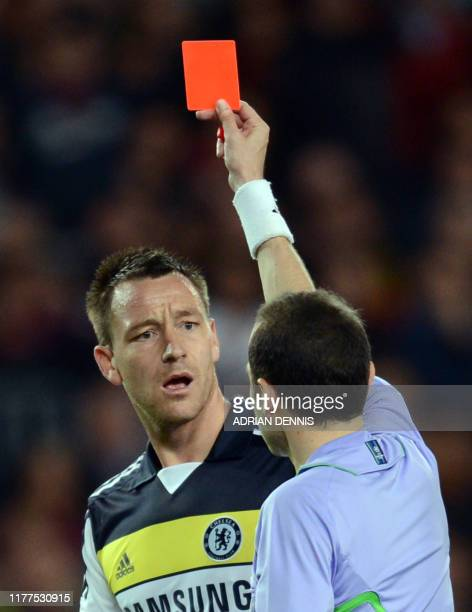 Chelsea's defender John Terry receives a red card from Turkish referee Cuneyt Cakir during the UEFA Champions League second leg semi-final football...