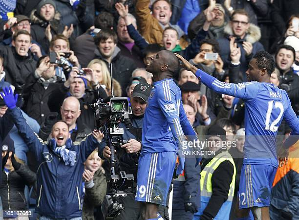 Chelsea's Demba Ba celebrates scoring a goal during the FA Cup quarter final replay football match between Chelsea and Manchester United at Stamford...