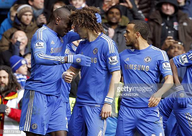 Chelsea's Demba Ba celebrates scoring a goal with Chelsea's Brazilian defender David Luiz during the FA Cup quarter final replay football match...