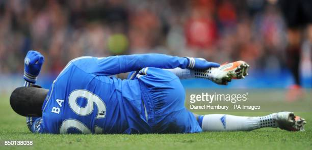 Chelsea's Dembe Ba holds his ankle after a heavy challange during the Barclays Premier League match at Stamford Bridge London