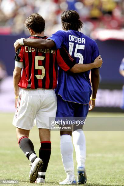 Chelsea's Didier Drogba and AC Milan's Alessandro Costacurta embrace each other during the game