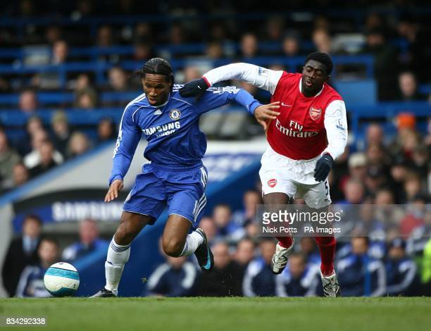 Chelsea's Didier Drogba and Arsenal's Kolo Toure battle for the ball